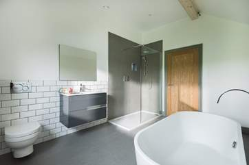 Choose from a relaxing bath in the huge tub or a shower in the large cubicle.