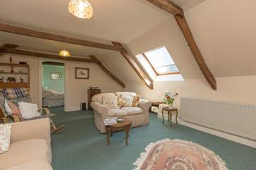 Another view of the living room which has plenty of light and is very friendly and cosy.