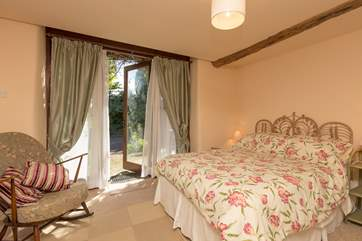 This is the ground floor double bedroom, with French Windows to the patio outside.