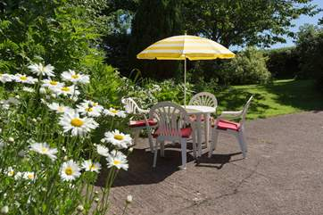 The gardens for you to enjoy are spread out beyond the hard standing area.