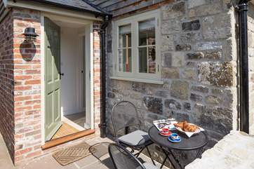 The little terrace catches the sun and is ideal for morning coffee. The enclosed garden is through the gate to the left of this photograph.