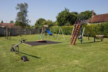 Plenty of space for running around safely in the village play area, 500 yards from Orchard View.