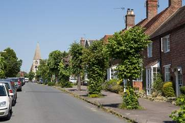 The quiet and pretty High Street in Hindon is lined with lime trees.