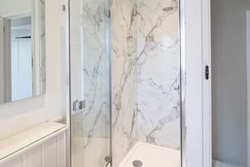 The first floor family bathroom has a shower cubicle as well as a bath.