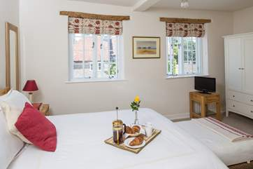 The spacious first floor master bedroom has views to the High Street and village church.