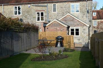The enclosed sunny garden is the perfect place for a BBQ.