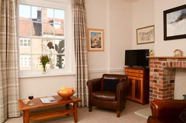 The cosy sitting-room is separate from the open plan space, with another television,