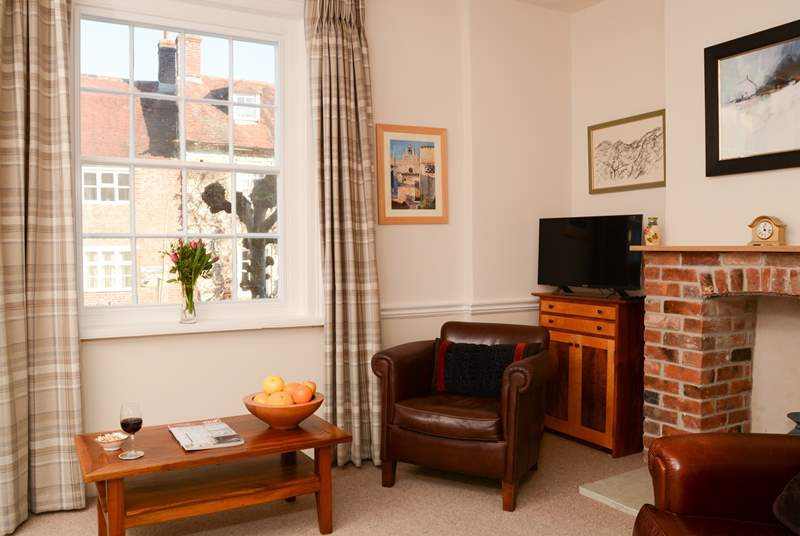 The cosy sitting room is separate from the open plan space, with another television,