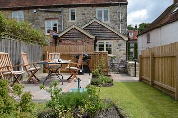 The enclosed very private and sunny garden is the perfect place for a BBQ.