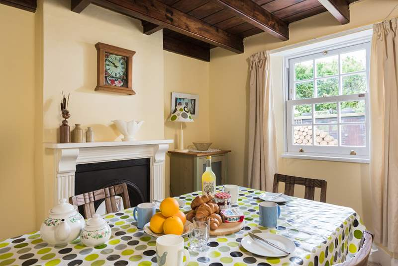 This pretty dining-room in this character cottage has a feature fireplace.