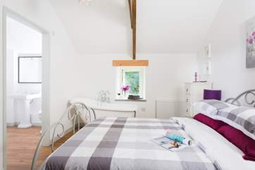 The lovely bedroom with a king-size bed and slipper bath, what could be nicer than a soak after a day walking the mining trails and coast paths?