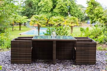 Take your food and drink up to the shared seating-area overlooking the swimming pool.