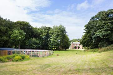 Looking back across the meadow to Reskadinnick House with the stables beyond.