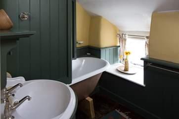 The carefully designed bathroom has a roll-top bath.