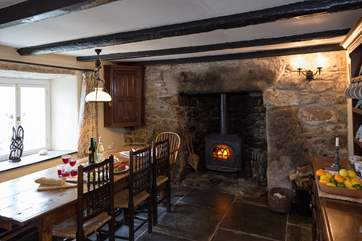 The wood-burner sits in an ancient inglenook fireplace in the dining-room.