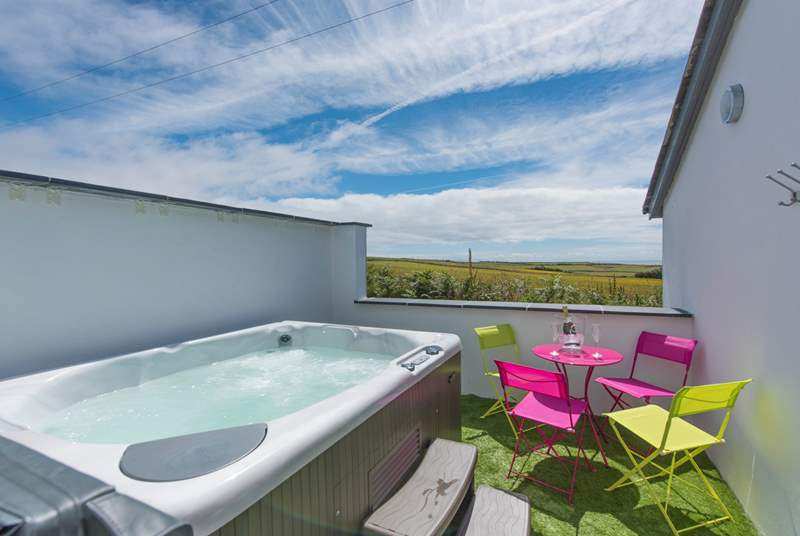Relax in the hot tub whilst taking in the spectacular views.