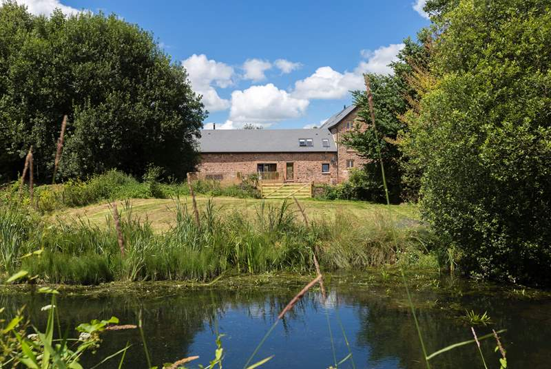 This is the back of the Long Barn. There is a large deck, a lovely garden and then a gate to a little meadow that borders the Tiverton Canal, a lovely stretch of clear water.There is a jetty there now