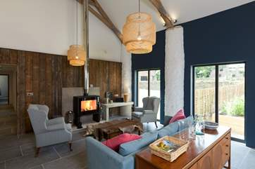 Another view of the sitting-room to show the stylish wood-burning stove.