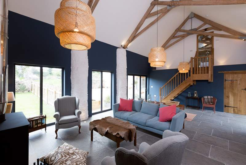 There is a fabulous high ceilinged sitting-room with slate floors and full under-floor heating as well as the wood-burning stove for out-of-season stays.