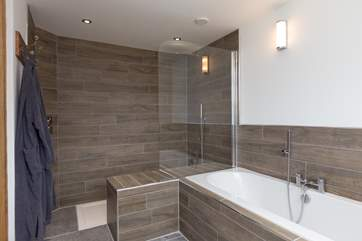 The ground floor bedroom has a bath and a walk-in shower which has been designed with built-in seating to help any guests who may have mobility problems.