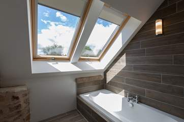 The en suite for Bedroom 2 has a bath as well as a large walk-in shower.