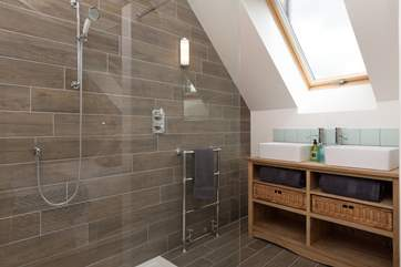 There is a huge shower with drench shower head as well as a standard shower head. The shower can be entered from both sides. This is the en suite for the first floor bedroom.