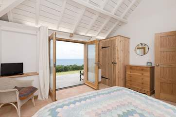 French doors open onto the terrace, you can lie in bed with a cup of tea and breathe in the sea air.