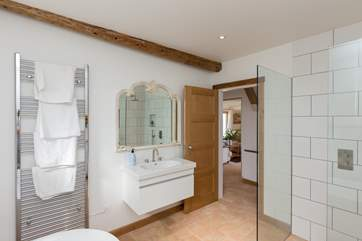 The huge bathroom has a walk-in shower cubicle in addition to the bath.