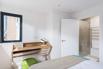 The fabulous en suite has a large shower cubicle with room for two!