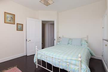This bedroom has a tiny little ensuite WC and wash basin - the door is just behind the open bedroom door in this photo.