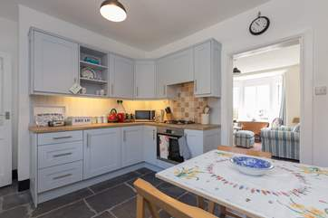 The kitchen/breakfast-room then leads to the living-room which is at the front of the house, with wonderful sea views.