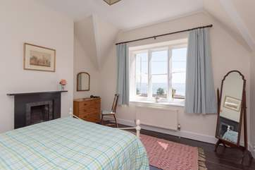 The double bedroom with sea views to take in from your bed - what a way to start the day. The little Victorian fireplace is a lovely feature.