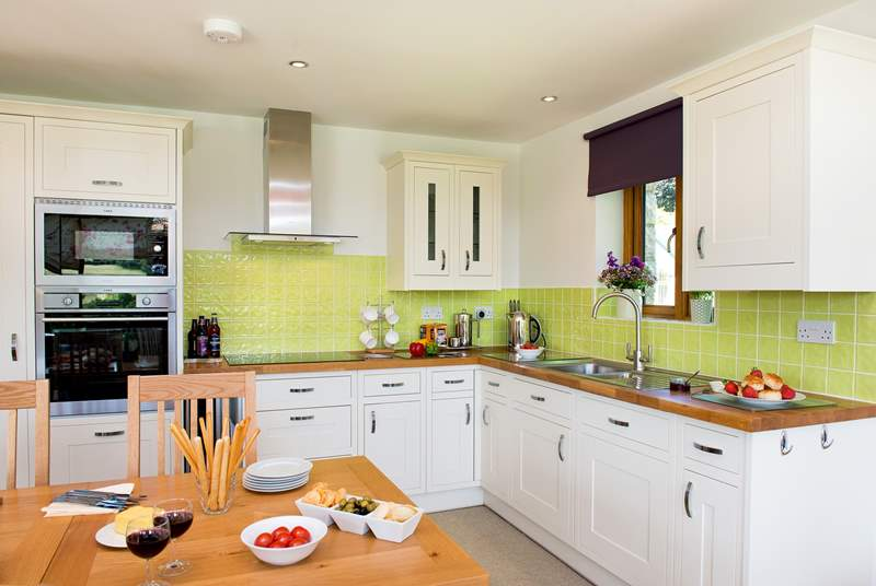 The kitchen is very light and airy and has all you need to cook up a treat.