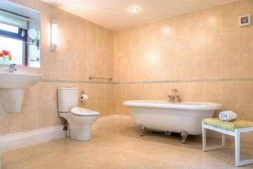 The bathroom is very spacious and has a gorgeous free-standing bath...