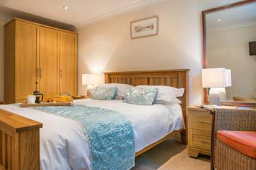 Both bedrooms are beautifully furnished and have lovely crisp white linen.