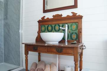 In the cabin, a beautiful late Victorian wash stand has been updated with a contemporary basin and hot and cold running water.