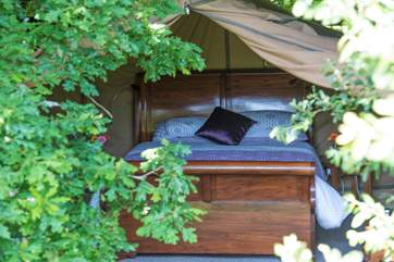 The safari tent has a big comfy bed and can offer two feather and down duvets to make it nice and cosy.
