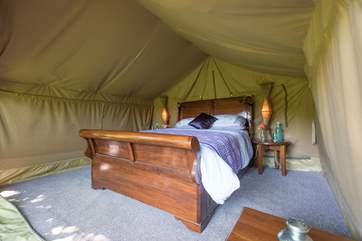 The safari tent bedroom is super romantic!