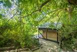 From the cabin, steps lead down to the romantic safari tent overlooking the lake.