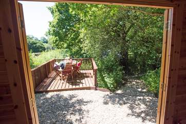 Double doors open onto a deck area, perfect for al fresco dining overlooking the lake.