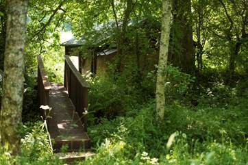 The bridge from the playing meadow back to the safari tent and cabin.