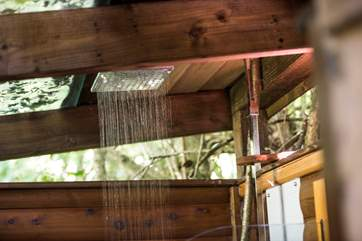The outdoor shower has hot water...no need to freeze just because you're showering al fresco!