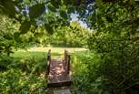 This little bridge crosses the stream to a large meadow with plenty of space for children to play.