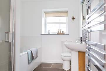 The family bathroom has both a bath and a separate shower cubicle.