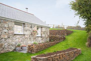The terraced lawn at the side of the cottage.