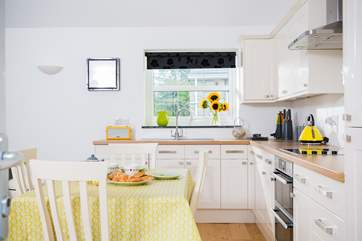 Lovely zingy colours add cheerfulness around the cottage.