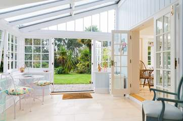 The conservatory leads out to the garden and hot tub.
