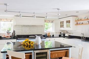 There's a four oven Aga and a huge kitchen island, perfect for big holiday meals.