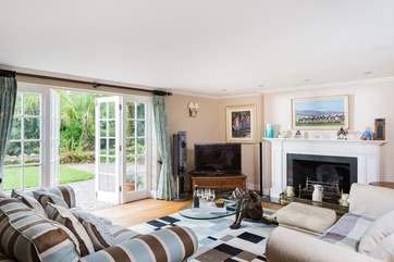 This sitting-room has doors out to the lawns and grounds.