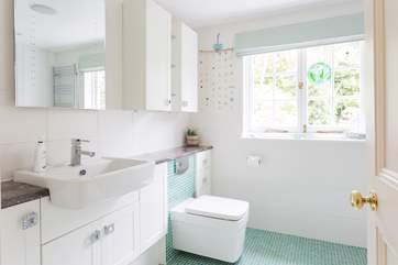 This shower-room is en suite to Bedroom 5.